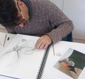 Working on a drawing at the Skills Centre